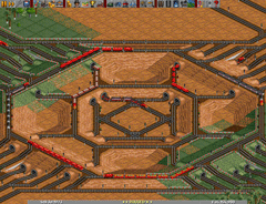 A complex four way junction in a sandy desert.
