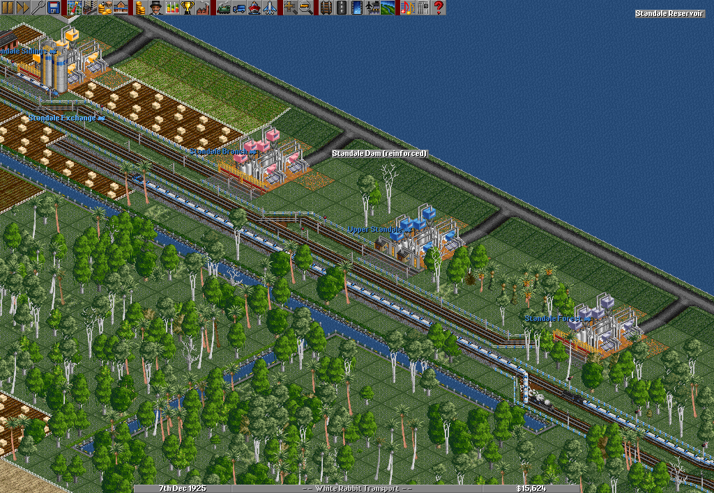 "In the picture coming from the most respected server for OpenTTD, ""Brianetta's Standard"", a risky business is going on. Flooding always a possibility, a reinforced dam holds back a huge reservoir. Several water pumps draw water off for transport all across the desert, promising mountains of gold for those daring enough to supply the large number of plantations and farms out there."