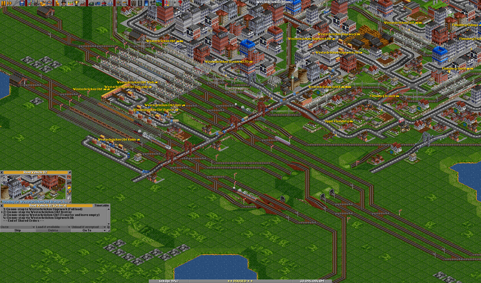 Crowded passenger station and a wood feeder service in a growing town.